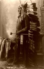 Sitting Bull. Headdress indicating a member of the Brave Hearts Society.
